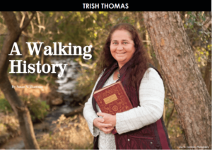 Trish Thomas posing with a history book